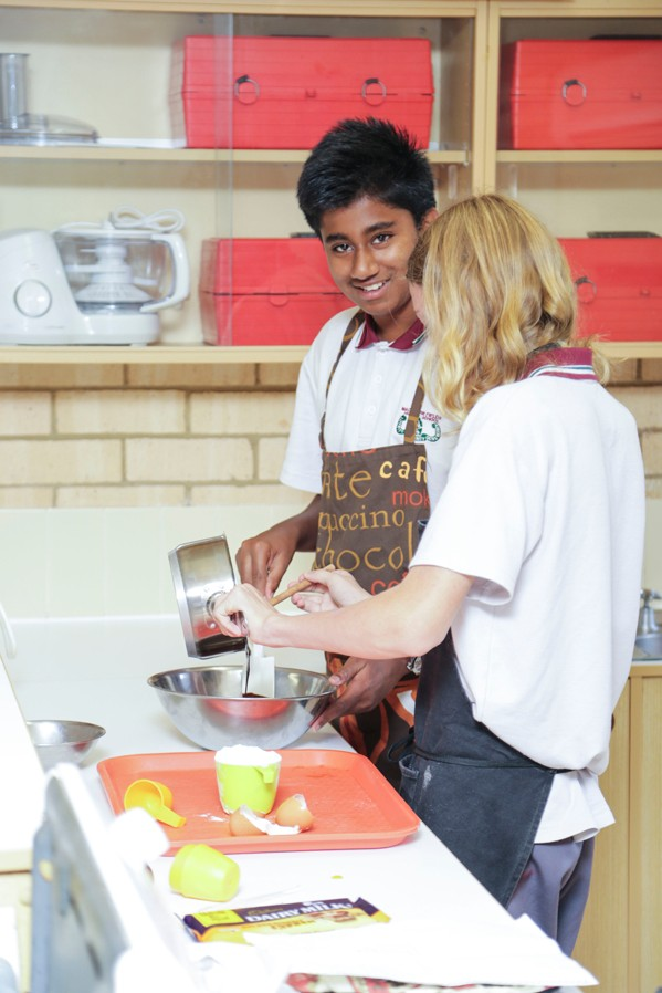 2 students cooking in the food technology kitchen